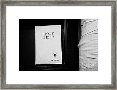 holy bible left by the gideons in a drawer at the side of the bed in a hotel room in Las Vegas Nevad Framed Print by Joe Fox
