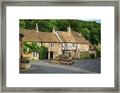 Homes And Shops Along The High Street Framed Print by Brian Jannsen
