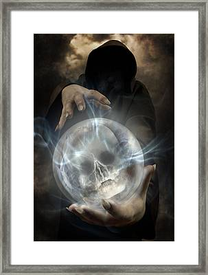 Hooded Man Wearing Dark Cloak Holding Glowing Crystall Ball With Human Skull Image Inside Framed Print by Jaroslaw Blaminsky