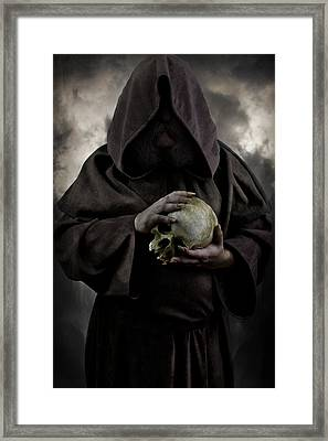 Hooded Moustached Man Wearing Dark Cloak And Holding A Human Skull In His Hands Framed Print by Jaroslaw Blaminsky