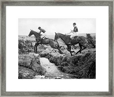Horses Jumping A Creek Framed Print by Underwood Archives