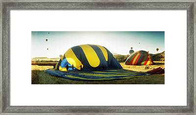 Hot Air Balloon Being Deflated Framed Print by Panoramic Images