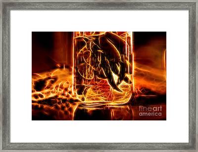 Hot Peppers In A Bottle Framed Print by Milan Karadzic