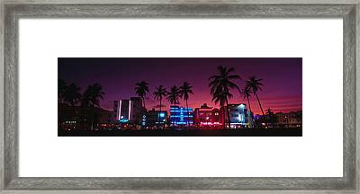 Hotels Illuminated At Night, South Framed Print by Panoramic Images