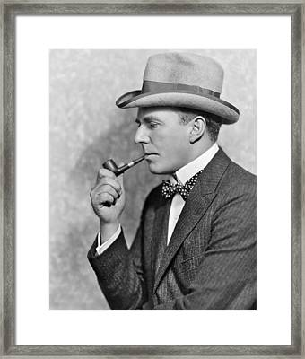 House Peters Smoking A Pipe Framed Print by Underwood Archives