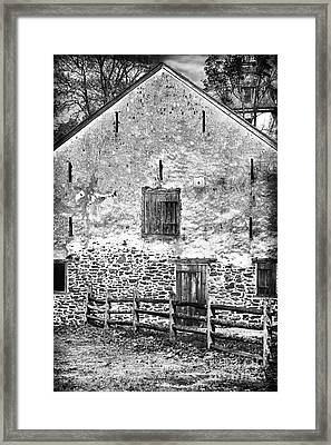House With The Fence Framed Print by John Rizzuto