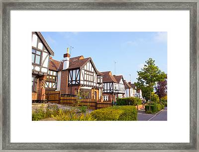 Houses In Woodford England Framed Print by Tom Gowanlock