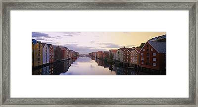 Houses On Both Sides Of A River Framed Print by Panoramic Images