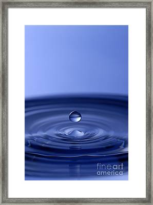 Hovering Blue Water Drop Framed Print by Anthony Sacco