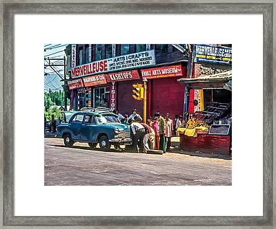 How To Change A Tire Framed Print by Steve Harrington