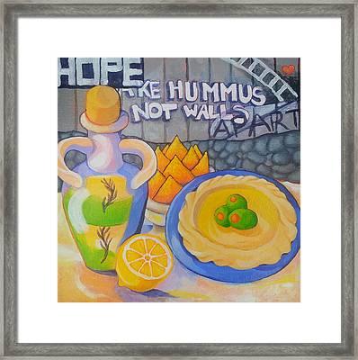 Hummus Behind A Wall Framed Print by Corey Habbas