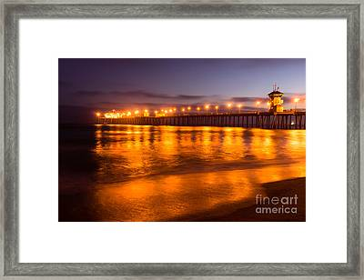 Huntington Beach Pier At Night Framed Print by Paul Velgos