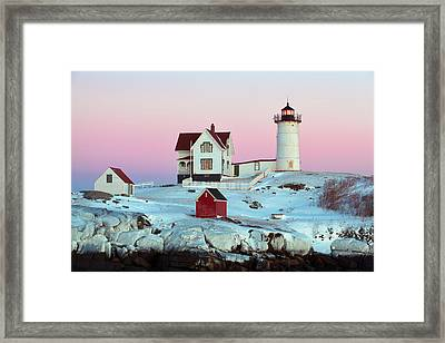 Icy Nubble Lighthouse Framed Print by Eric Gendron