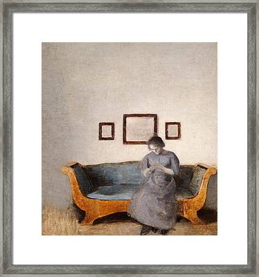 Ida Hammershoi Sitting On A Sofa Framed Print by Vilhelm Hammershoi