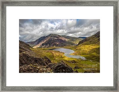 Idwal Lake Snowdonia Framed Print by Adrian Evans