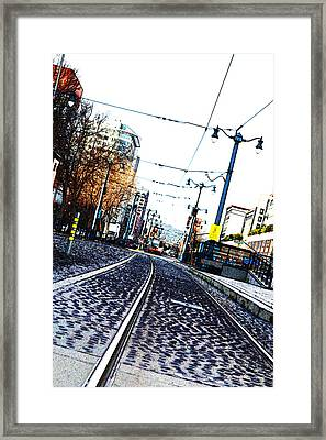In The Path Of A Cable Car Framed Print by Holly Blunkall