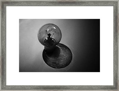 In The Shadows Framed Print by Martin Newman