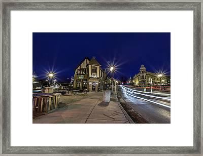 In The Village Framed Print by CJ Schmit