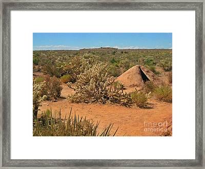 Indian Earth Shelter In The Desert Framed Print by John Malone