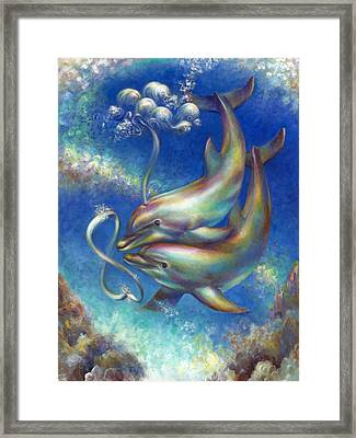 Infinity- Bottlenose Dolphins At Play Framed Print by Nancy Tilles