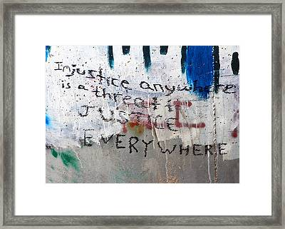 Injustice Framed Print by Munir Alawi