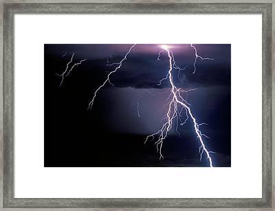 Intense Cloud-to-ground Lightning Strike Framed Print by Thomas Wiewandt