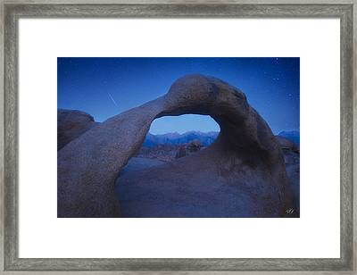 Intergalactic Portal Framed Print by Peter Coskun