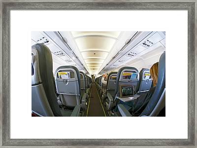 Interior Of A Passenger Airliner Framed Print by Victor De Schwanberg