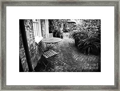 Into The Courtyard Framed Print by John Rizzuto