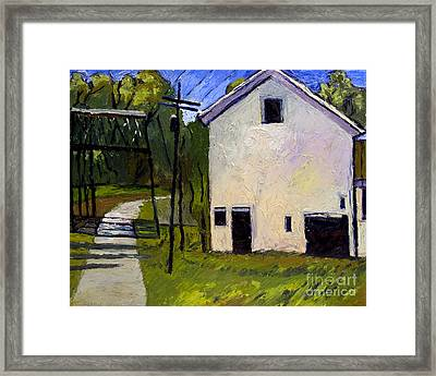 Iron And Wood And Sun Framed Print by Charlie Spear
