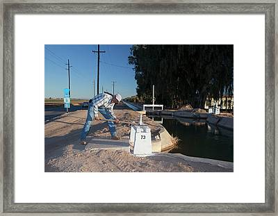 Irrigation Sluice Being Opened Framed Print by Jim West