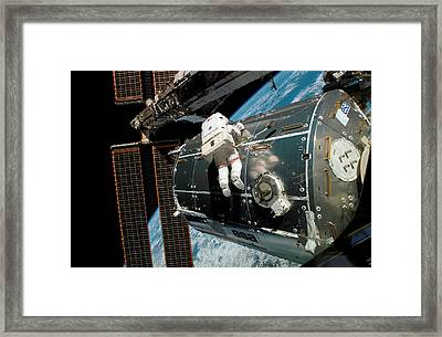 Iss Columbus Module Installation Framed Print by Nasa