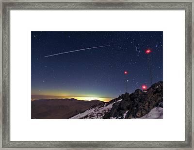 Iss Crossing The Night Sky Framed Print by Babak Tafreshi