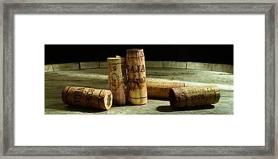 Italian Wine Corks Framed Print by Jon Neidert