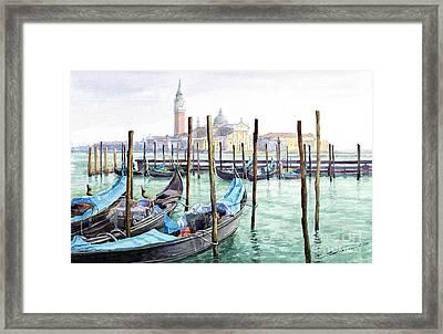 Italy Venice Gondolas Parked Framed Print by Yuriy Shevchuk