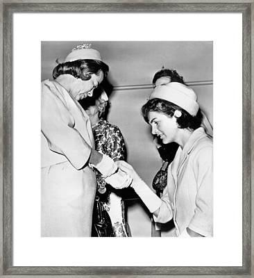 Jackie Inspects Gold Bracelet Framed Print by Underwood Archives