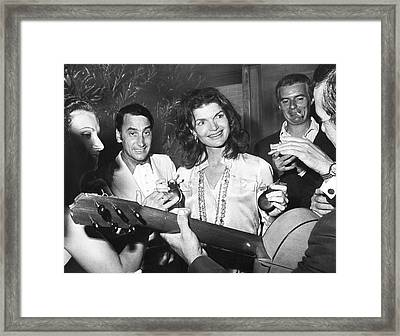 Jackie Kennedy Playing Music Framed Print by Underwood Archives