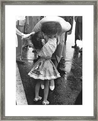 Jacqueline Bestows A Kiss Framed Print by Underwood Archives