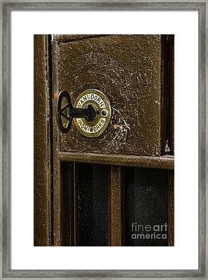 Jail Cell Door Lock  And Key Close Up Framed Print by Paul Ward