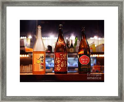Japanese Sake Bottles In A Bar Framed Print by Oleksiy Maksymenko