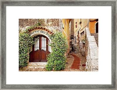 Jasmine Covered Entryway To Shop Framed Print by Brian Jannsen