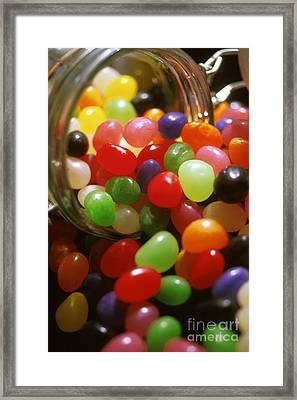 Jelly Beans Spilling Out Of Glass Jar Framed Print by Anonymous