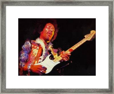 Jimi Hendrix On Guitar Framed Print by Dan Sproul