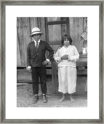 Jivaro Headhunter And His Wife Framed Print by Underwood Archives
