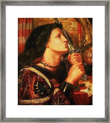 Joan Of Arc Kissing The Sword Framed Print by Dante Gabriel Charles Rossetti