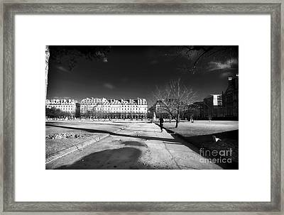 Jogging In Paris Framed Print by John Rizzuto