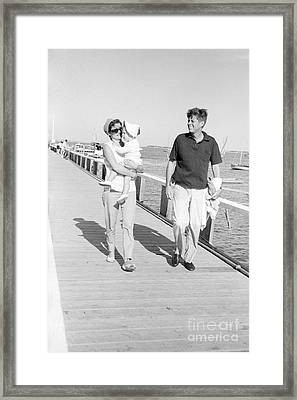 John F. Kennedy And Jacqueline Kennedy At Hyannis Port Marina Framed Print by The Phillip Harrington Collection