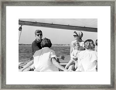 John F. Kennedy And Jacqueline Sailing Off Hyannis Port Framed Print by The Phillip Harrington Collection