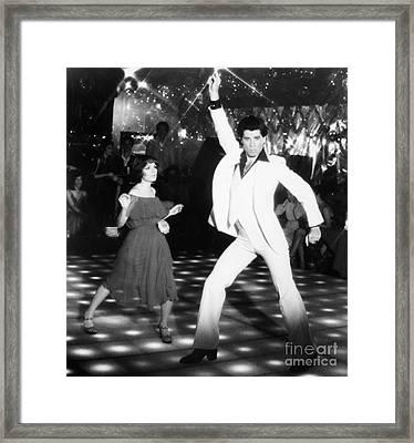 John Travolta (1954- ) Framed Print by Granger