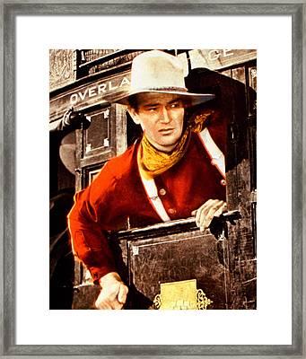John Wayne In Stagecoach  Framed Print by Silver Screen